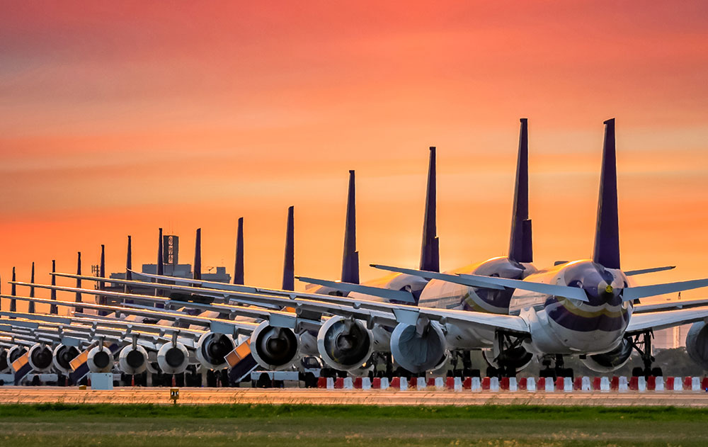 Airplanes lined up on runway